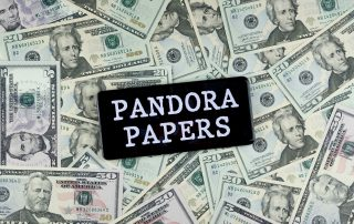 Pandora Papers on a pile of money