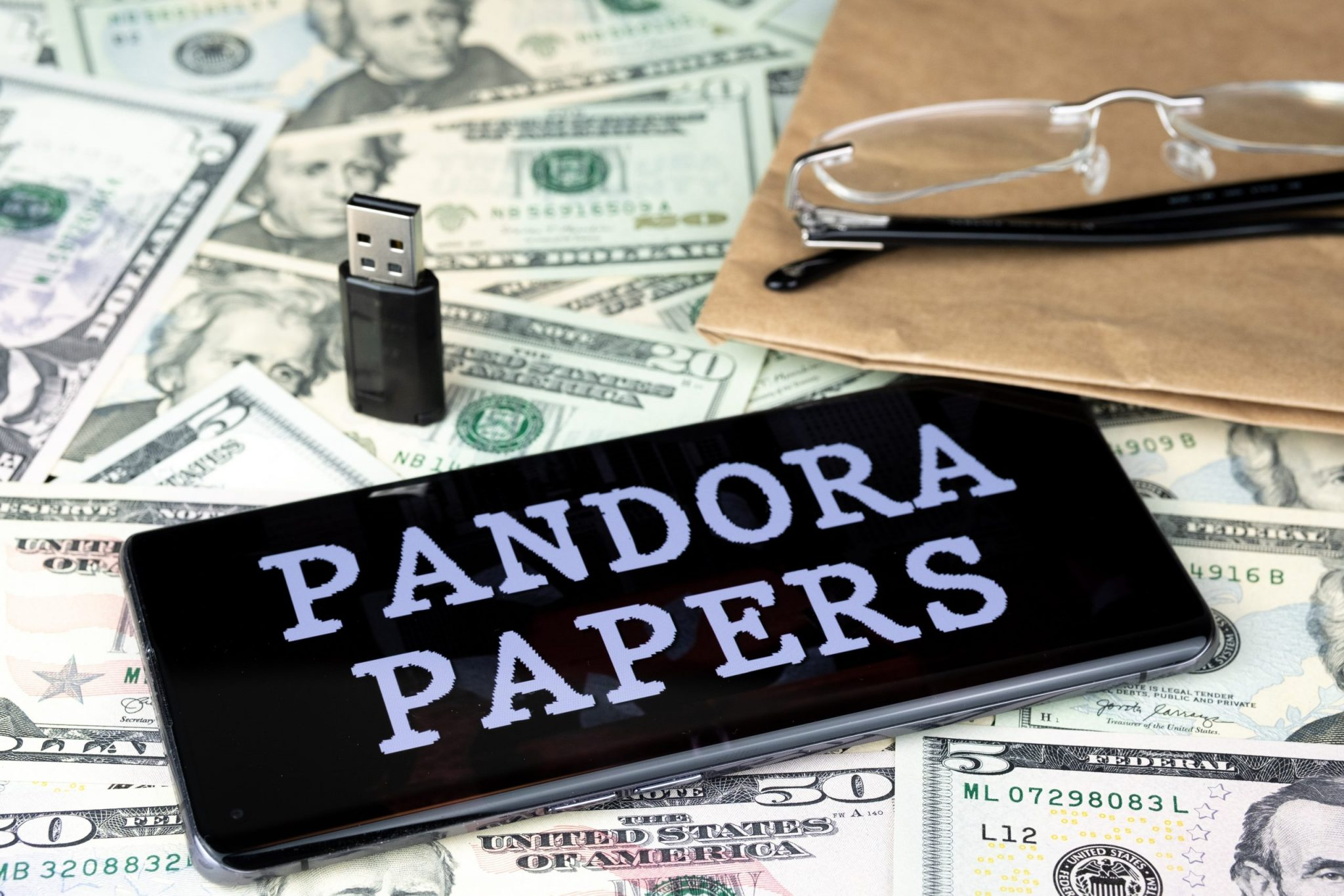 Pandora Papers on pile of money